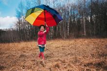 Girl Holding An Open Umbrella ...