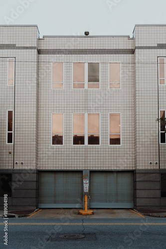 Minimalist Urban Metallic Roller Shutter Garage Doors Street View