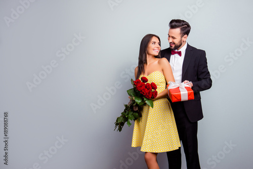Fotografie, Obraz  Portrait with copy space of attractive couple in formal wear, woman in dress hol