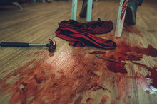 Hammer In Blood Lying On The Wooden Floor In Pool Of Blood. Selective Focus,