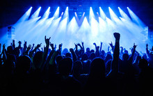 Crowd Raising Hand In The Air And Enjoying Concert On A Festival