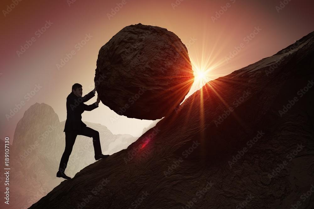 Fototapety, obrazy: Sisyphus metaphore. Silhouette of businessman pushing heavy stone boulder up on hill.
