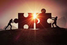 Teamwork, Partnership And Cooperation Concept. Silhouettes Of Two Businessman Joining Two Pieces Of Puzzle Together.