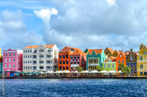 Photo Stands Caribbean Brightly Colored Buildings in Curacao