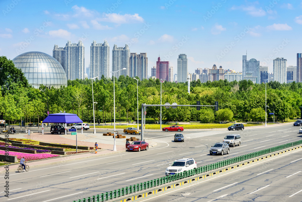 Fototapety, obrazy: Harbin, the capital and largest city of Heilongjiang in China. Text on the guideboard translate into English is Taiyang Road and Songbei Road, near the Sun Island Park and Harbin Ice and Snow World.