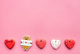 Sweets on Valentine's Day. Cookies in shape of heart and with lettering I love you on pink background top view copy space