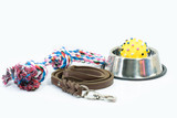 Fototapeta Zwierzęta - Pet supplies set about stainless bowl, rope, rubber toys and leather of leash for dog or cat on white background