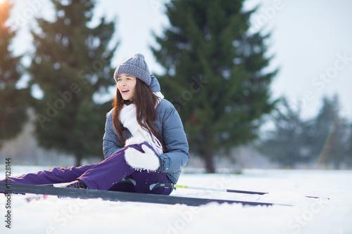 Fotobehang Wintersporten Young skier hurt her leg during ski training and feeling sharp pain