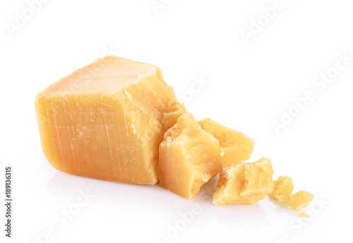 Pieces of parmesan cheese isolated on white background.