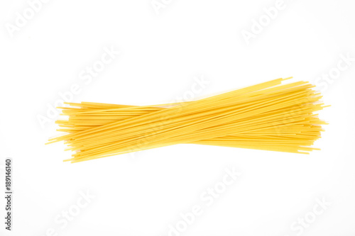 Uncooked pasta spaghetti macaroni isolated on white background Canvas