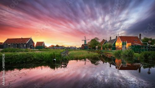 Dutch landscape with windmill at dramatic sunset, Zaandam, Amsterdam, Netherlands
