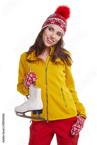 Smiling young woman carrying a pair of ice skates Poster