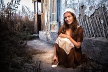 Sad Woman In A Rustic Dress Si...
