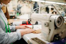 Tailor Hands Sews Fabrics On A...