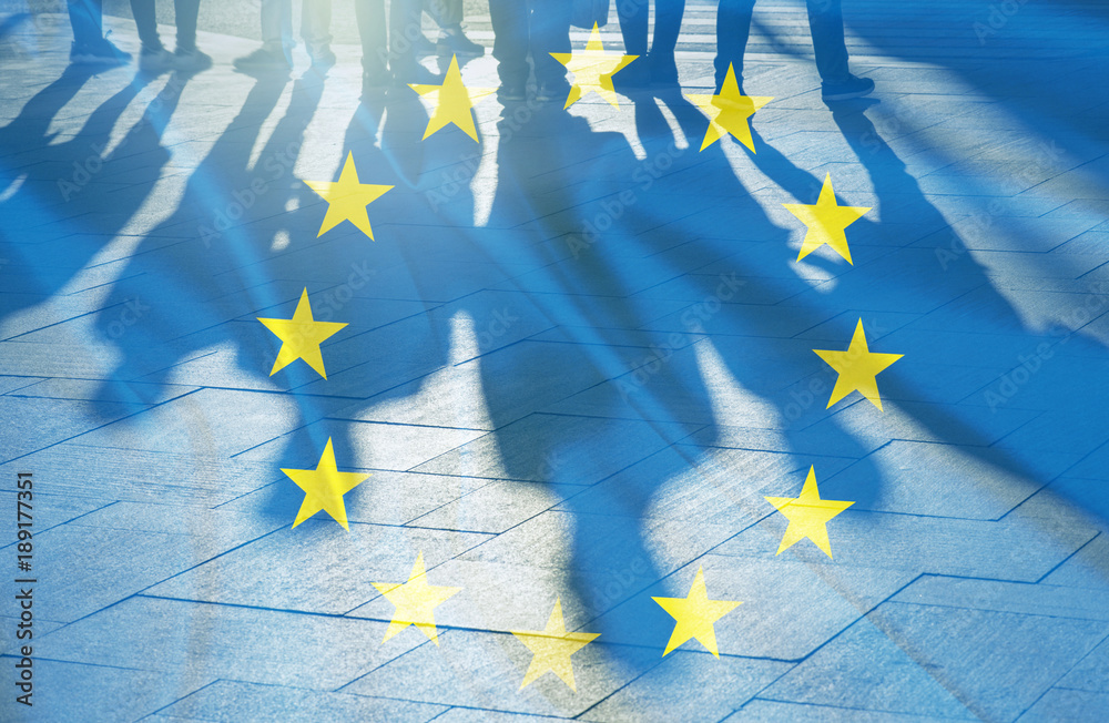 Fototapeta EU Flag and shadows of People concept picture