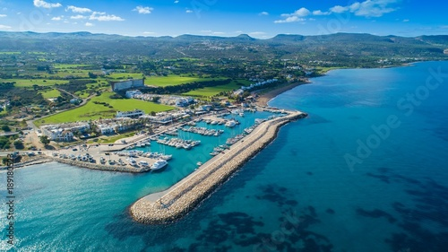 Fotobehang Cyprus Aerial bird's eye view of Latchi port, Akamas peninsula, Polis Chrysochous, Paphos,Cyprus. Latsi harbour with boats and yachts, fish restaurant, promenade, beach tourist area and mountains from above