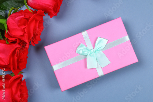pink roses with a gift box tied with a bow template for march 8