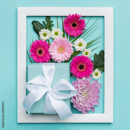 Happy Mother's Day, Women's Day, Valentine's Day or Birthday Pastel Candy Colors Background. Floral flat lay minimal concept with beautifully wrapped present.