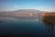 Panoramic view from the Varese lake with the Campo dei Fiori mountain in the background.