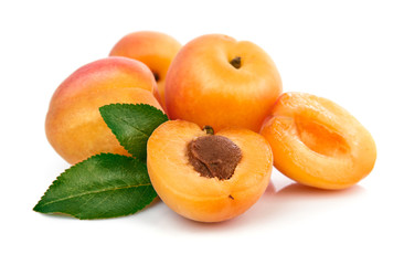 Fresh apricots in section with green leaves still life of ripe