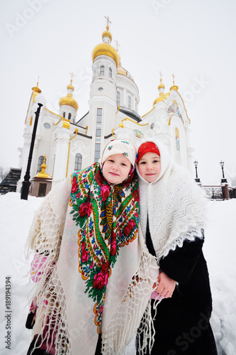 Christmas Christening.Two Little Girls In Fur Coats And Shawls In Russian Style