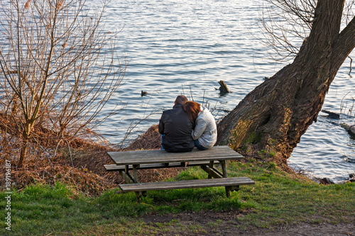 Two Lovers Contemplate The Lake Sitting On The Park Bench Buy