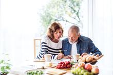Senior Couple Eating Breakfast...