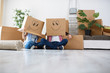 Leinwanddruck Bild - Funny young couple enjoy and celebrating moving to new home