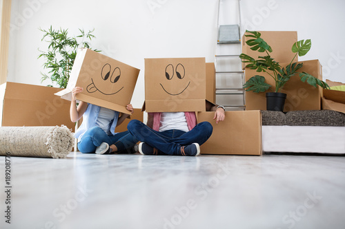 Canvastavla  Funny young couple enjoy and celebrating moving to new home