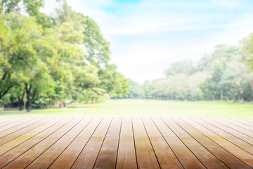 Empty wooden table with party in garden background blurred.
