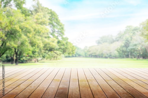 Poster Garden Empty wooden table with party in garden background blurred.