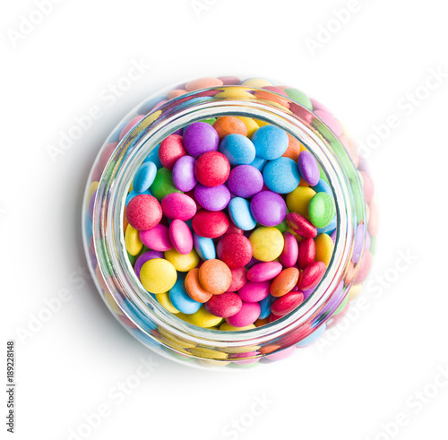 Foto op Aluminium Snoepjes Colorful chocolate candies in jar.