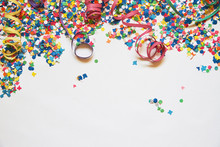 Confetti And Serpentine On A White Background. Carnival. Abstract Frame For Text. Holiday, Birthday, Anniversary, Greeting Card