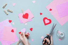 Valentines Day Background. Hands Making Valentine Card With Heart And On The Blue Background