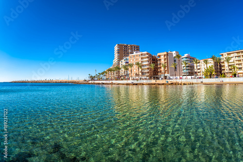 Beach and cityscape. Torrevieja, Spain