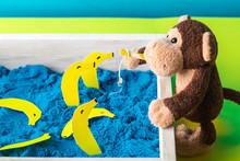 Monkey Toy Fishing Bananas