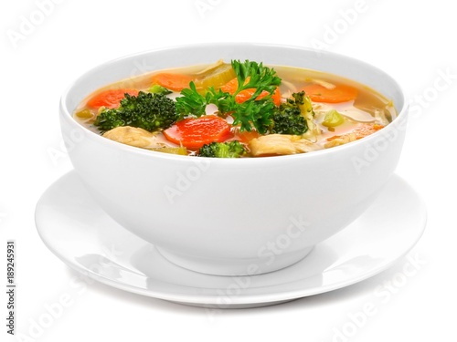 Fotografija Homemade chicken vegetable soup in a white bowl with saucer
