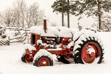 Old Red Tractor Covered In Snow