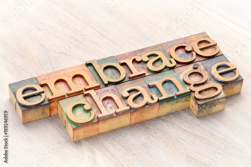 Fotomural embrace change word abstract in wood type