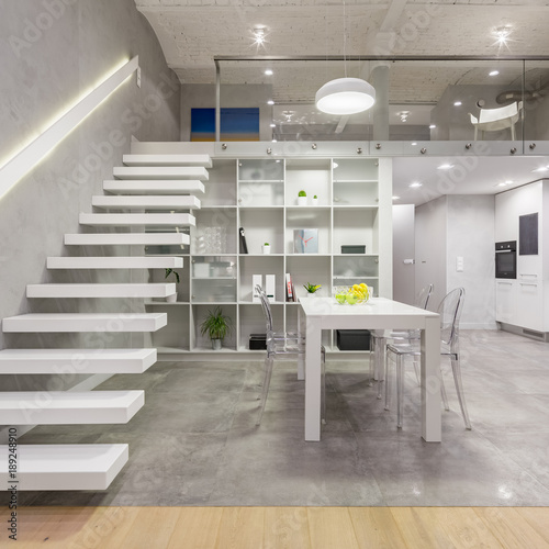 Staande foto Industrial geb. Apartment with white staircase