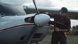 Aircraft mechanic polishing plane