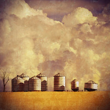 Grunge Vintage Textured Farm Silos And Wheat Field With Cloud-filled Sky Background Illustration