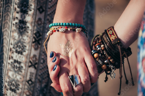 Photo  close up hands with boho accessories