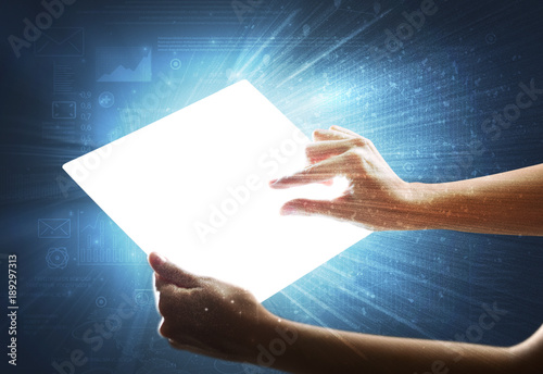Fototapety, obrazy: Hands touching a glass-like tablet