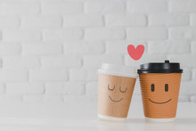 Two Coffee Cup With Smiling Fa...