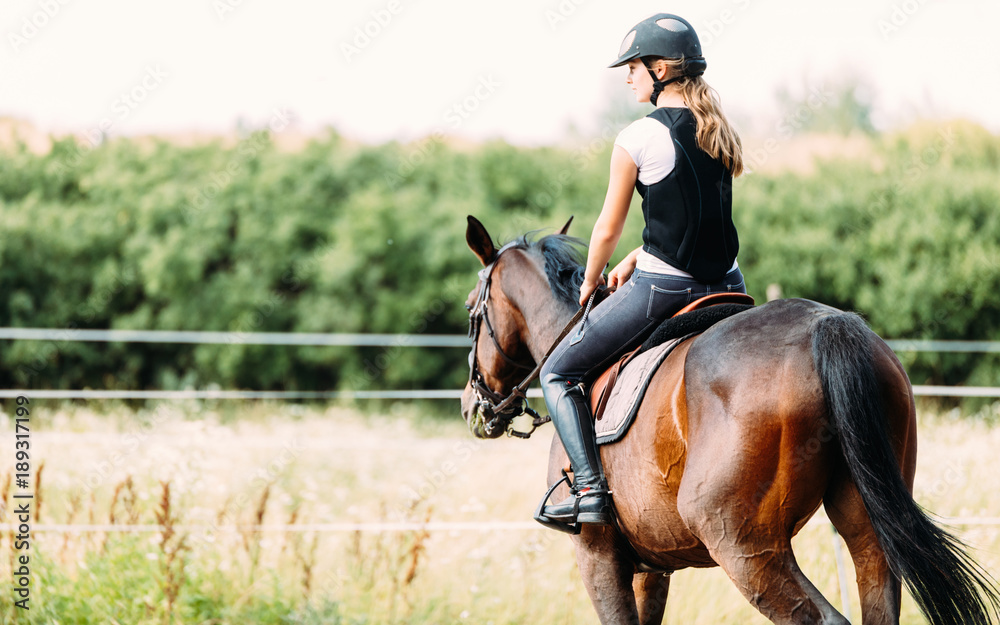 Fototapety, obrazy: Picture of young girl riding her horse