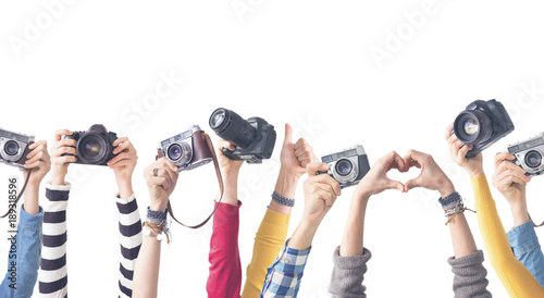 Different color hands holding  Cameras Wallpaper Mural