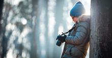 Boy Using Digital Camera Takin...