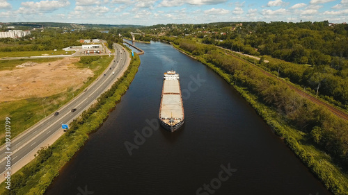 Fotografia  Aerial view:Barge with cargo on the river