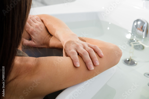 Valokuvatapetti woman relaxing receiving water procedures in spa salon